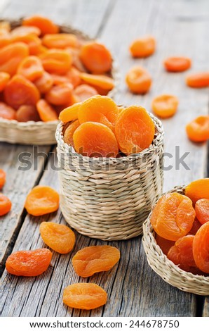 dried apricots on a dark wood background. tinting. selective focus #244678750