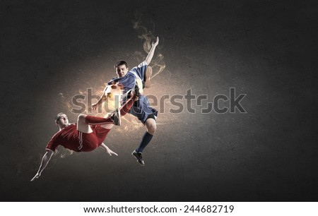 Two football players in jump fighting for ball #244682719