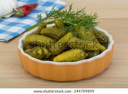 Pickled small cucumber with dill and spices #244709899