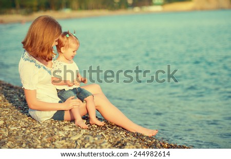 happy family mother and child on the beach by the sea #244982614