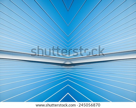Abstract detail of a big suspension bridge steel support cables against clear blue sky