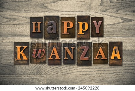 "The words ""HAPPY KWANZAA"" written in vintage wooden letterpress type."