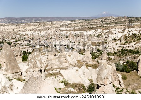 Cappadocia, Turkey. The picturesque Valley of Pigeons with pillars of weathering and the ancient city of Uchisar #245101090