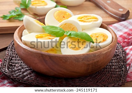 Boiled eggs in a bowl decorated with parsley leaves Royalty-Free Stock Photo #245119171
