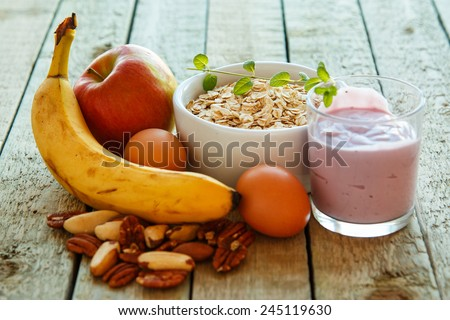 Healthy breakfast on the kitchen table Royalty-Free Stock Photo #245119630