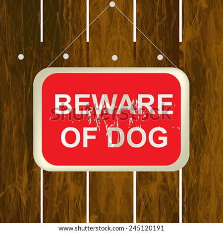 Beware of dog sign on a wooden fence #245120191