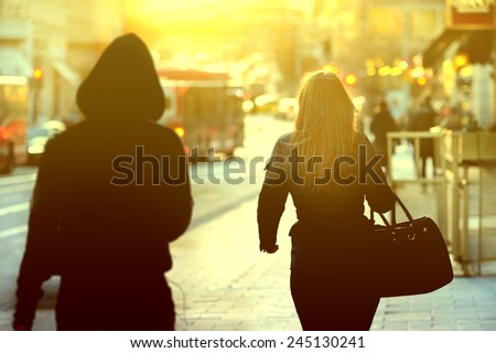 Woman being followed Royalty-Free Stock Photo #245130241