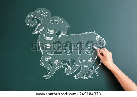drawing sheep with 2015 on blackboard