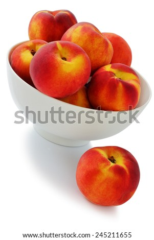 Ripe peaches in a vase on a white background #245211655