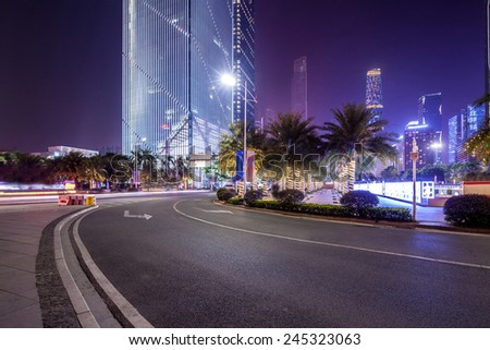 curved light trails on the city road in guangzhou central business district with modern buildings at night  #245323063