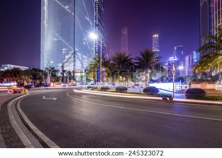 curved light trails on the city road in guangzhou central business district with modern buildings at night  #245323072