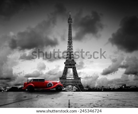Artistic image of Effel Tower, Paris, France and red retro car. Black and white, vintage.