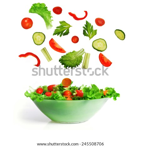 salad with lettuce and other fresh vegetable on white dish. #245508706