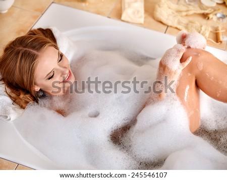 Young woman wash leg in bathtube. #245546107
