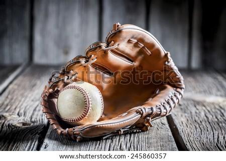 Age Baseball glove and ball Royalty-Free Stock Photo #245860357