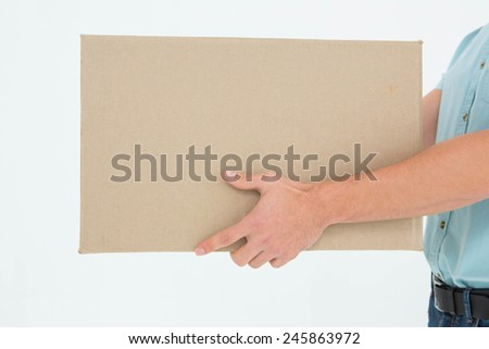 Cropped image of delivery man carrying cardboard box on white background #245863972