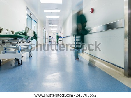 Doctors and nurses walking in hospital hallway, blurred motion.  Royalty-Free Stock Photo #245905552