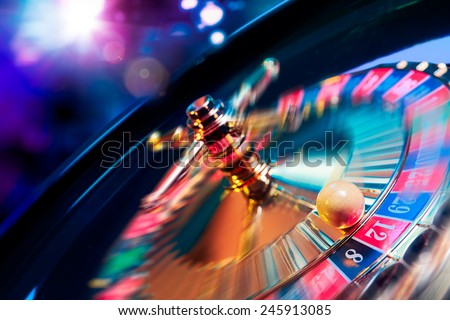 high contrast image of casino roulette in motion Royalty-Free Stock Photo #245913085