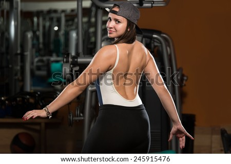 Portrait Of A Physically Fit Young Woman - Flexing Muscles #245915476