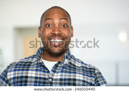 Portrait of African American businessman smiling inside office building #246050440