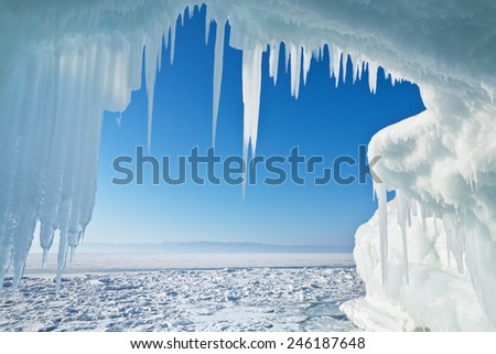 View of the frozen Lake Baikal through the ice arch with icicles Royalty-Free Stock Photo #246187648