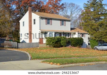 Suburban high ranch home autumn clear blue sky day residential neighborhood USA #246213667