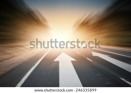 Conceptual image of asphalt road and direction arrow #246335899