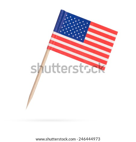 Miniature paper flag USA. Isolated American Flag on white background. With shadow below #246444973