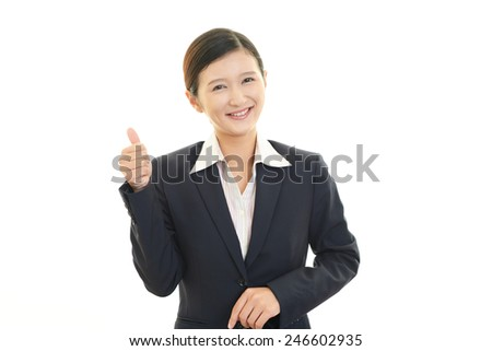 Business woman showing thumbs up sign #246602935