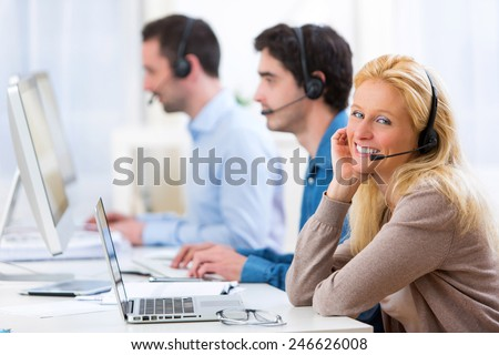 View of a Young attractive woman working in a call center #246626008