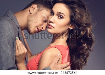 Fashion photo of sexy elegant couple in the tender passion. Studio portrait #246673564