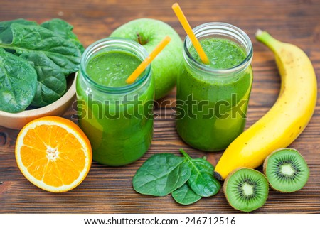 Blended green smoothie with ingredients selective focus  #246712516