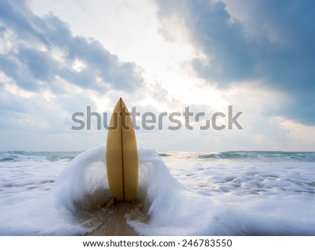 Surfboard on the beach at sunset #246783550