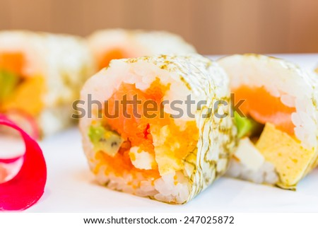 Salmon sushi roll maki - japanese food - selective focus #247025872