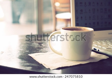 vintage color tone of  cup of coffee  on the table coffee shop #247075810