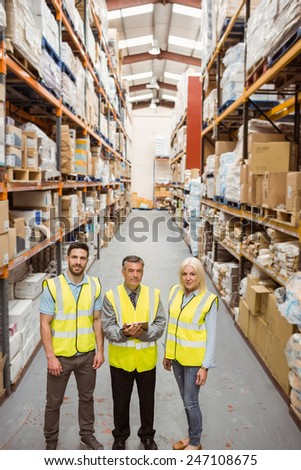 Warehouse team smiling at camera in a large warehouse #247108675