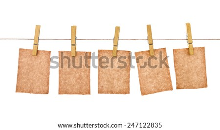 kraft paper hang from clothespins on isolated white background #247122835