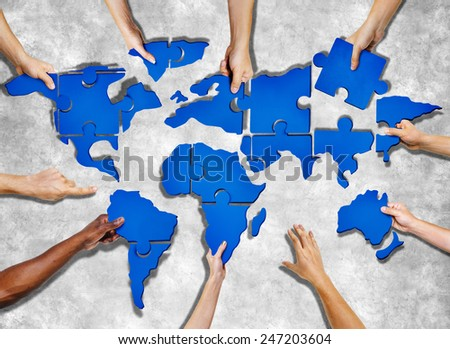 Aerial View of People Forming World Map with Puzzle Pieces #247203604