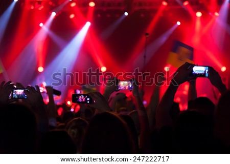 People at concert shooting video or photo. #247222717