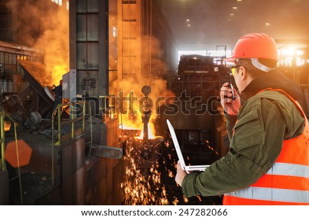 Engineer with laptop controlling work in foundry #247282066