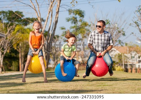 Dad and children playing on the lawn in front of house at the day time #247331095