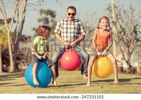 Dad and children playing on the lawn in front of house at the day time #247331101