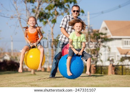 Dad and children playing on the lawn in front of house at the day time #247331107