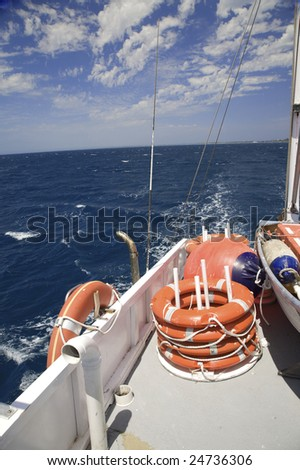View Looking out Back of Fishing / Tourism Boat #24736306