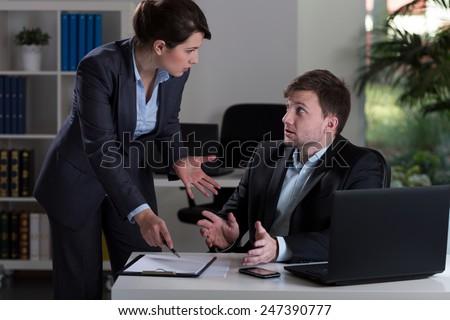 Horizontal view of boss yelling at employee Royalty-Free Stock Photo #247390777