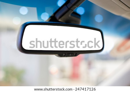Rear view mirror in the car Royalty-Free Stock Photo #247417126