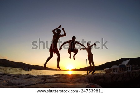 Friends jumping at sunset on the beach #247539811
