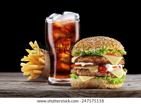 Hamburger, potato fries, cola drink. Takeaway food. Fast food. Royalty-Free Stock Photo #247575118