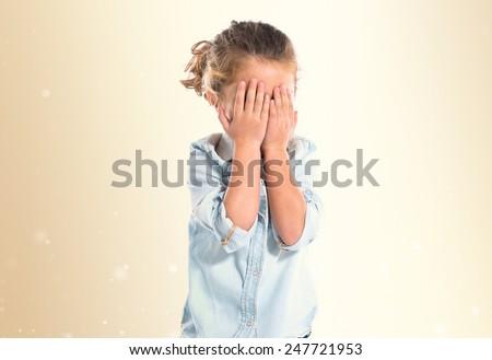 Blonde kid covering her eyes #247721953