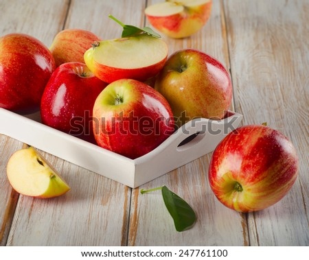 Fresh ripe apples  in a wooden white box . Selective focus #247761100